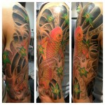 Koi fish 3/4 sleeve tattoo