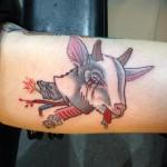 Severed goats head tattoo