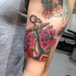Anchor and roses tattoo
