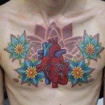 Heart and flowers chest tattoo