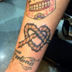 Traditional knot tattoo