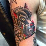 Wolf and bible tattoo
