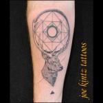 Geometric stag linework tattoo