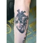 Dot work heart tattoo
