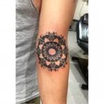 Dot style mandala tattoo
