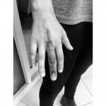 Finger lotus mandala pattern tattoo