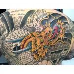 Dragon backpiece tattoo in progress