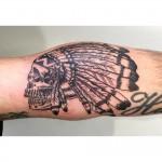 Skull and headdress tattoo