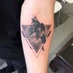 Geometric raven tattoo