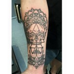Skull and mandala tattoo