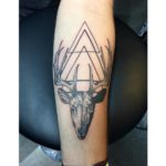Dotwork deer and triangles tattoo