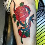 Traditional rose and snake tattoo