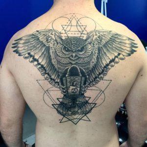 Dotwork owl backpiece tattoo